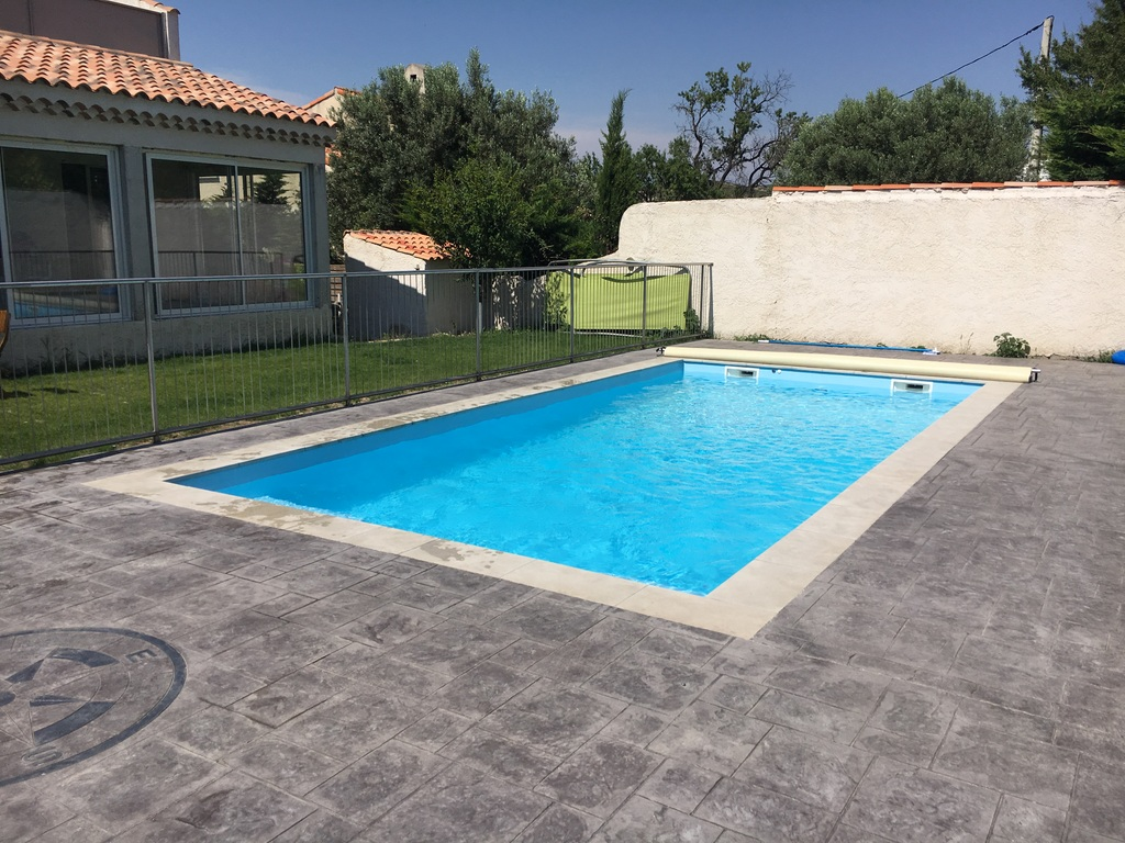 Passion piscines arguin for Prix volet immerge piscine 8x4